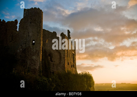 Laugharne Castle in West Wales at sunrise - Stock Photo