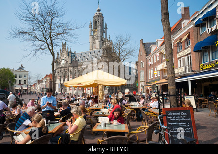 A street cafe at the market square in front of the late-Gothic town hall of Middelburg. - Stock Photo