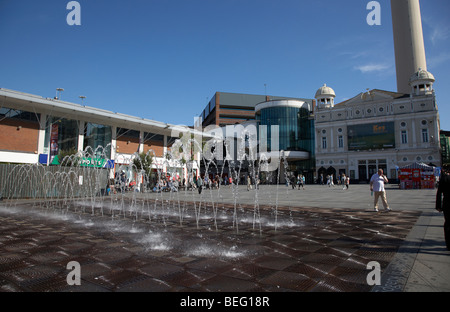 fountain water display in williamson square with the playhouse in the background in liverpool city centre liverpool - Stock Photo