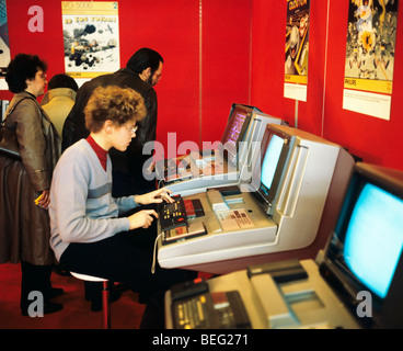 1980s Computer playstations exhibition, teenager boy playing video games at video arcade computer, France - Stock Photo