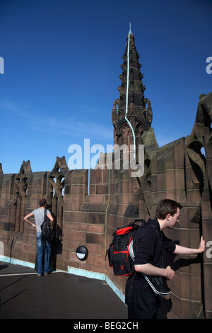 tourists looking down from the vestey tower the belltower of the Cathedral Church of Christ Liverpool Anglican Cathedral - Stock Photo