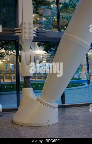An engineering 'Foot Node' that supports Terminal 5 roof standing on the floor of Arrivals at Heathrow airport. - Stock Photo