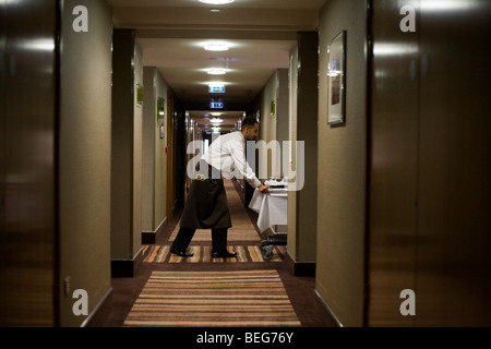 A hotel waiter delivers a meal ordered from room service in the Heathrow Airport Sofitel, attached to Terminal 5. - Stock Photo