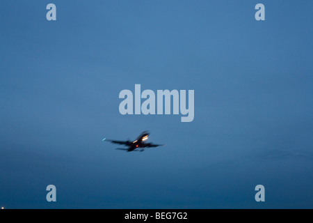 Second of a sequence of 4 consecutive images, a blurred jet airliner passes overhead, nearing its final airport - Stock Photo