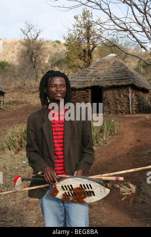 Young Zulu Guide Holding Spear And Shield Taken In KwaZulu-Natal Province, South Africa - Stock Photo