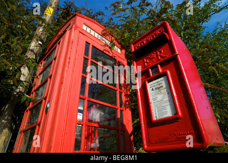 Old style telephone kiosk and post box in an English village in Sussex UK - Stock Photo