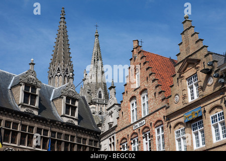 Detail of the Cloth Hall and Flemish gabled houses in the Grote Markt. - Stock Photo