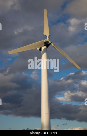 Wind Turbine against cloudy sky - Stock Photo