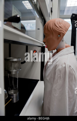 Biosafety cabinet is being certified with a dummy scientist - Stock Photo