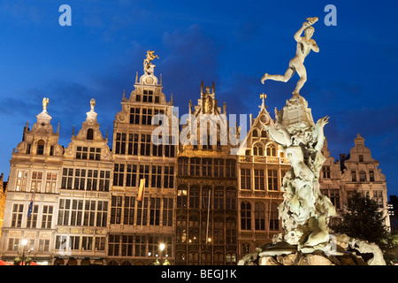 Renaissance Guild Halls and Brabo Fountain in the Grote Markt at dusk. - Stock Photo