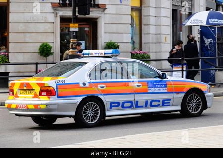 Police car at speed in Trafalgar Square - Stock Photo