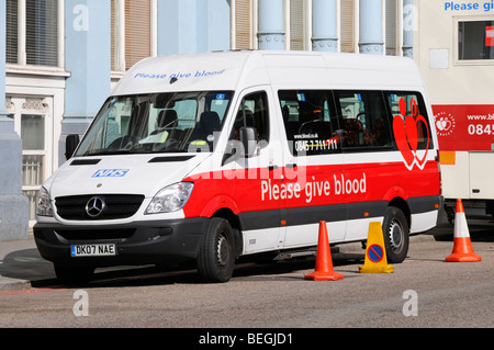 NHS Blood donor mobile collection vehicles parked in London street - Stock Photo