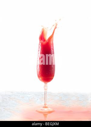 Tomato juice splash in glass white background - Stock Photo