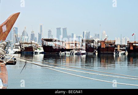 A view of the dhow harbour in Doha, Qatar, with the modern high-rise skyline beyond. - Stock Photo