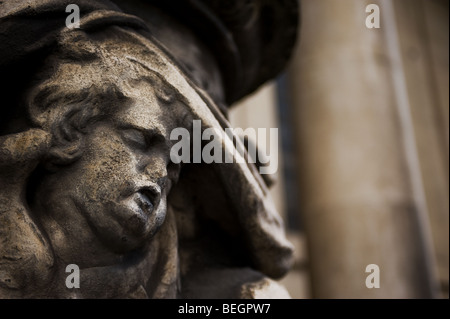 A stone sculpture of a cherub suffering from erosion and pollution damage in London.  Photo by Gordon Scammell - Stock Photo