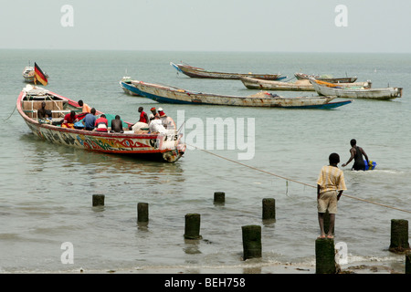 Bringing in the catch, Tanje fish market, The Gambia - Stock Photo