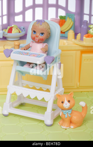 young child doll in a high chair - Stock Photo