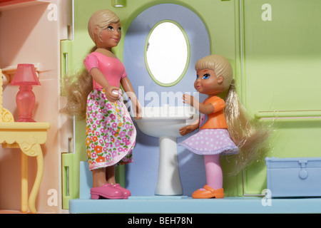 Mother and child dolls in the bathroom - Stock Photo