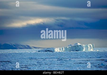 Spitsbergen, iceberg drifting in pack ice - Stock Photo