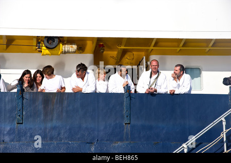 Spitsbergen, passengers on deck after they took an Arctic plunge - Stock Photo