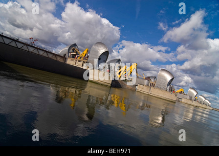 Horizontal wide angle of the Thames Flood Barrier reflected in the river, closed for maintenance work in London - Stock Photo
