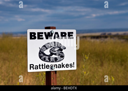 Beware rattlesnakes caution sign in the South Dakota mid-west grasslands - Stock Photo