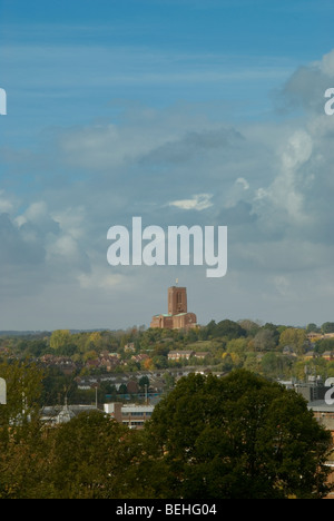 Portrait view of Guildford Cathedral on top of stag hill from above the town centre - Stock Photo