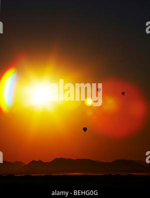 hot air balloons at sunset Namib-Naukluft Park Sossusvlei,  in Namibia - Stock Photo