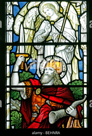 A stained glass window depicting Gideon holding a ram's horn, All Saints Church, Warham, Norfolk - Stock Photo