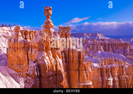 Morning light and fresh powder on Thor's Hammer and hoodoos below Sunrise Point, Bryce Canyon National Park, Utah - Stock Photo