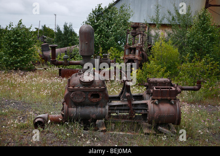 Abandoned mining equipment at Quincy Mine in Hancock Michigan USA rusty machine - Stock Photo
