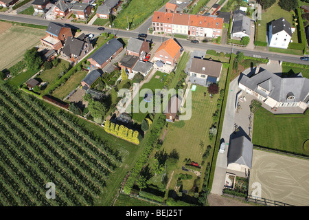 Urbanisation at the border of agricultural area with fields from the air, Belgium - Stock Photo