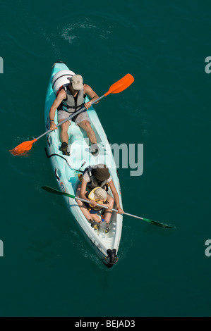 Tourists paddling in a canoe on the Lac de Sainte-Croix, Provence, France - Stock Photo