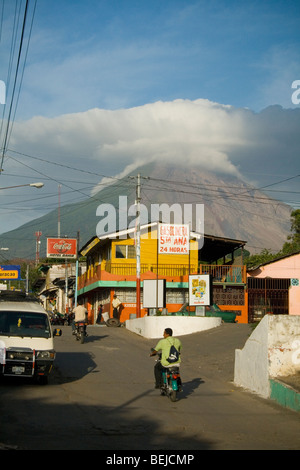 Moyogalpa street scene with volcano concepcion in the background - Stock Photo