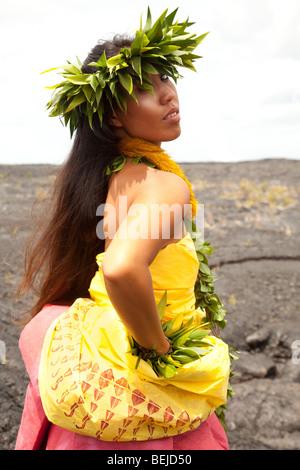 Young Hawaiian woman wearing traditional hula attire. - Stock Photo