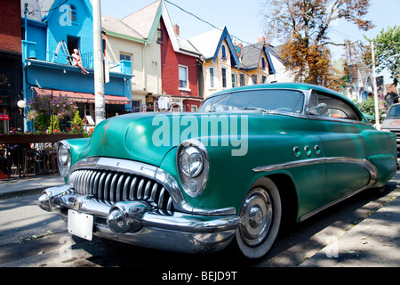 Green Classic car parked in Kensington market, Toronto, Canada - Stock Photo