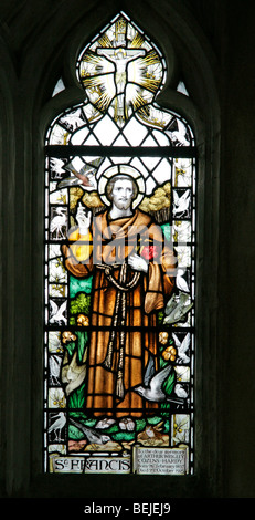 A stained glass window depicting St Francis of Assisi, St Margaret of Antioch Church, Cley-next-the-Sea, Norfolk - Stock Photo