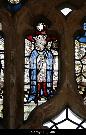 Detail of a medieval stained glass window depicting King Edmund, St Mary's Church, Stody, Norfolk - Stock Photo