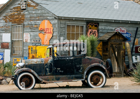 Old Ford vintage car along the Route 66 at the general store of the ghost town Hackberry in Arizona, USA - Stock Photo
