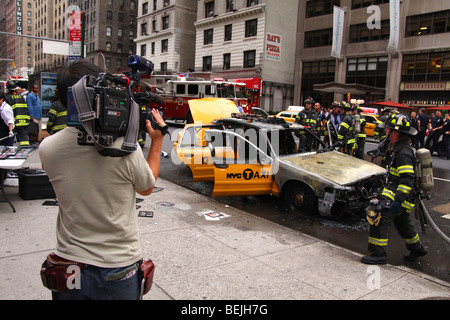 Taxi Fire, near to Times Square, Large Clouds of Black Smoke Seen.03Sep2009. Corner of 53rd and Seventh Ave. Large - Stock Photo