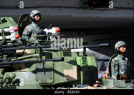 Military parade marking Chinas 60th anniversary of the Peoples Republic of China, soldiers on a tank. 01-Oct-2009 - Stock Photo