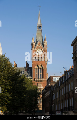 The clock tower of St Pancras Railway Station, & part of St Pancras Chambers building – formerly Midland Grand Hotel. - Stock Photo