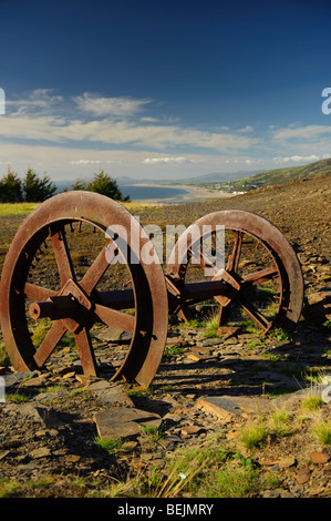 autumn afternoon Old slate mining quarrying equipment lying rusting and abandoned in a quarry above Friog Gwynedd - Stock Photo