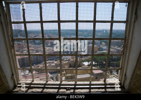 Rome's view from a window at the path leading to the top of Saint Peter's Dome - Stock Photo