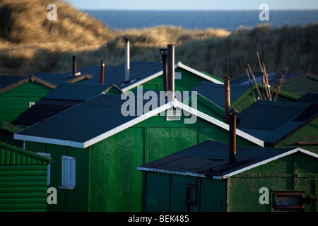Several Tarpaulin roofed Fisherman's huts with chimneys at Redcar near Middlesbrough, Teesside, North Yorkshire - Stock Photo