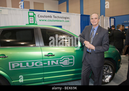Chuck Reed, Mayor of San Jose, poses by Saturn Vue plug-in hybrid preproduction vehicle, courtesy of General Motors - Stock Photo
