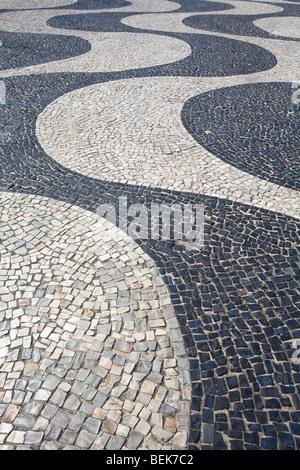 Pattern on a footpath, Copacabana, Rio de Janeiro, Brazil - Stock Photo