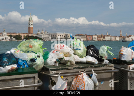 Venice Italy. Rubbish litter collection public services island of La Giudecca. Looking towards Campanile Bell Tower - Stock Photo