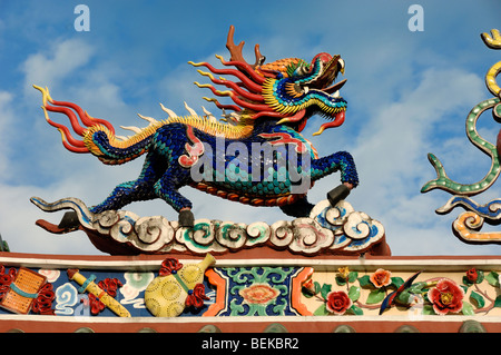 A Ceramic Chinese Dragon on the Roof of the Hong San Chinese Temple in Chinatown Kuching Sarawak Malaysia Borneo - Stock Photo