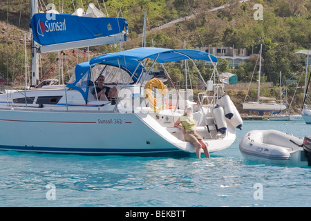 People relaxing on a Sunsail charter yacht at Soper's Hole, BVI - Stock Photo